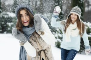 Young women have fun during the snowball fight