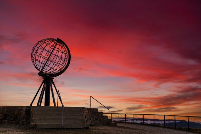 Symbolic globe at the North Cape at sunset. Nordkapp, Norway