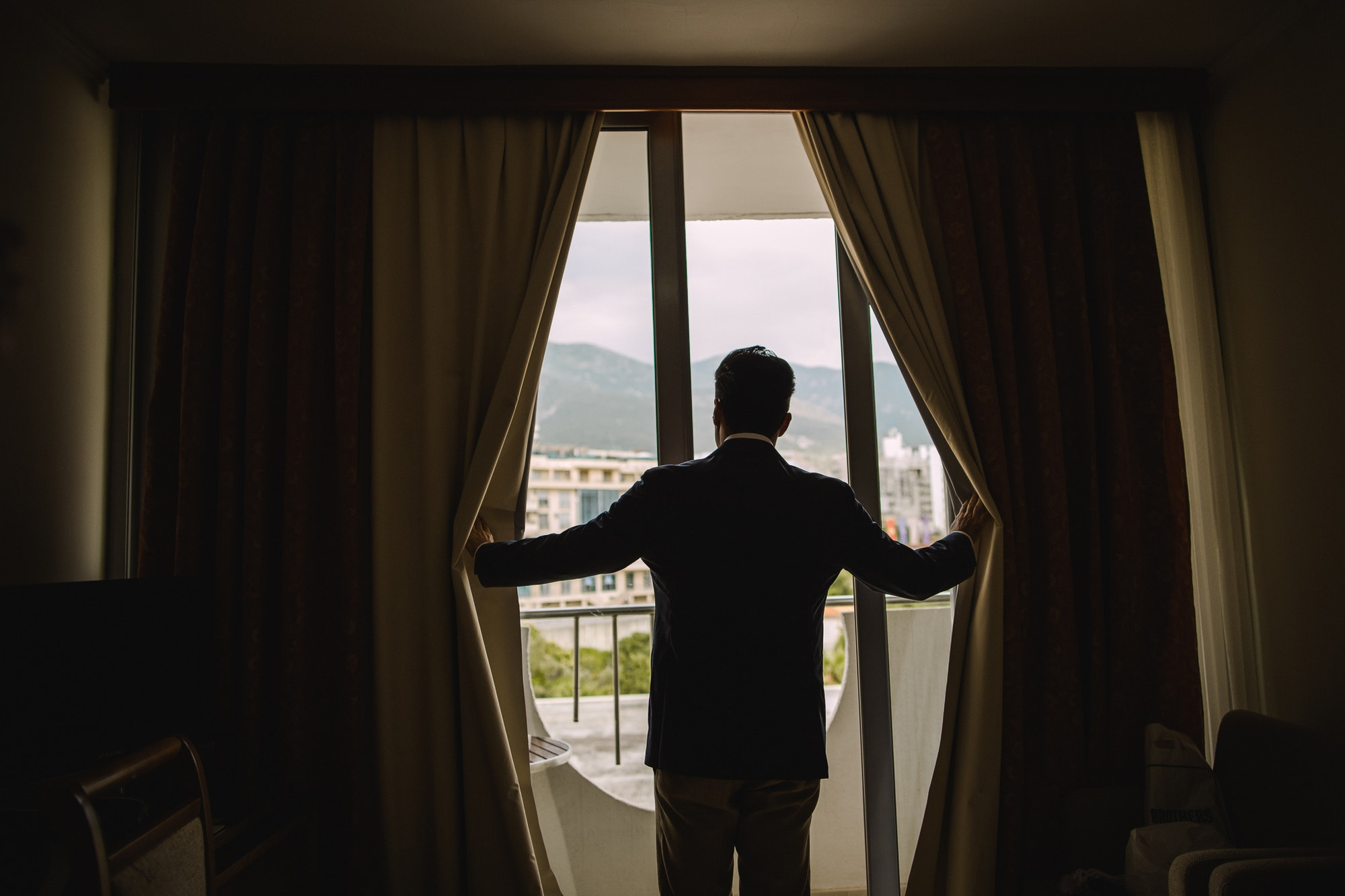 man looking at window in hotel