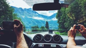 Driving in mountains and taking photos from the drivers seat