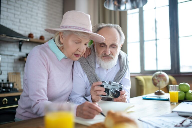 Elderly man and woman deciding on their upcoming travel