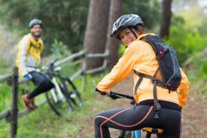 Female biker with mountain bike in countryside